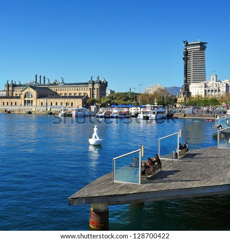 BARCELONA, SPAIN - JANUARY 26: Port Vell and Columbus Monument on January 26, 2013 in Barcelona, Spain. The monument for Christopher Columbus is a 60 meters tall structure at the end of La Rambla - stock photo