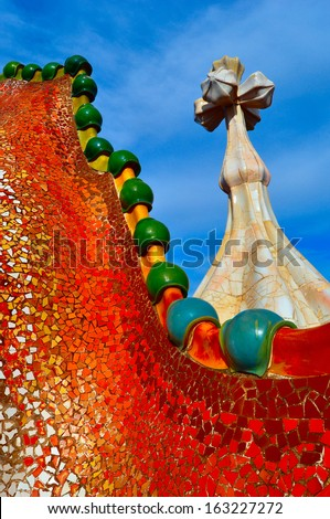 BARCELONA,SPAIN - JANUARY 30: Rooftop of the house Casa Battlo (also called the house of bones) designed by Antoni Gaudi with his famous expressionistic style on January 30, 2013 Barcelona, Spain  - stock photo