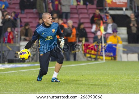 BARCELONA, SPAIN - JANUARY 27: Victor Valdes of FCB in action at the Spanish League match between FC Barcelona and Osasuna, final score 5 - 1, on January 27, 2013, in Barcelona, Spain. - stock photo