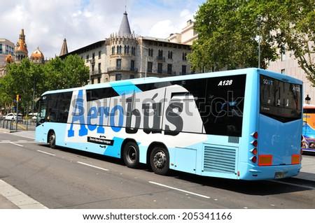 BARCELONA, SPAIN - JULY 08, 2012: Aerobus airport transfer in Placa de Catalunya (Catalonia Square) in central Barcelona - stock photo
