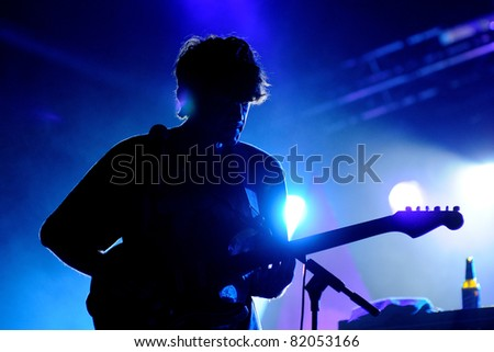 BARCELONA, SPAIN - JULY 28: Alex Scally, guitarist of Beach House band, performs at Poble Espanyol on July 28, 2011 in Barcelona, Spain. Fly Me to the Moon Festival. - stock photo