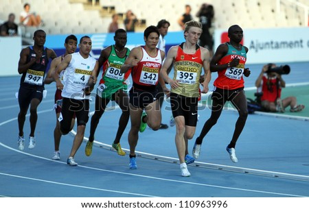 BARCELONA, SPAIN - JULY 14: athletes compete in the 800 meters final on the 2012 IAAF World Junior Athletics Championships on July 14, 2012 in Barcelona, Spain. - stock photo