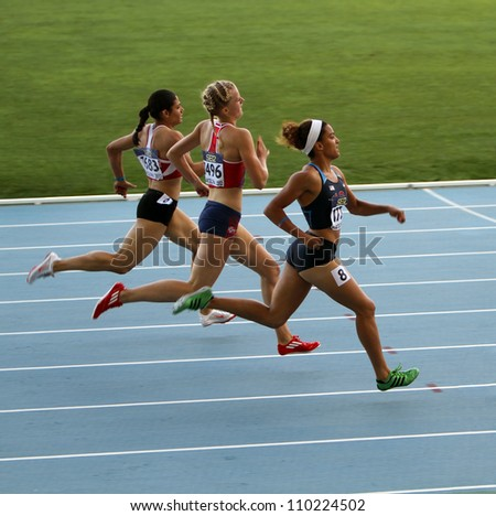 BARCELONA, SPAIN - JULY 13: Athletes in the 400 meters hurdles on the 2012 IAAF World Junior Athletics Championships on July 13, 2012 in Barcelona, Spain - stock photo