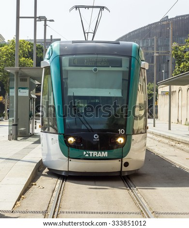 BARCELONA, SPAIN - JULY 12, 2015: Barcelona tram known as Trambaix. The tram is going through the Diagonal avenue.