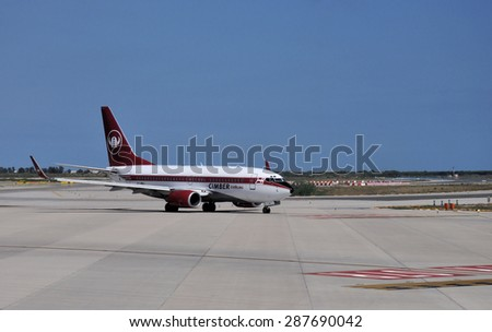 BARCELONA, SPAIN - JULY 20: Cimber Sterling airplane taxis to the terminal at Barcelona El Prat Airport on July 20, 2014. SAS acquired 100% of the shares in Cimber Sterling in 2014.