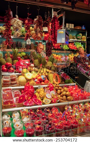 BARCELONA, SPAIN - JULY 09, 2014: Famous La Boqueria market - one of the oldest markets in Europe.  - stock photo