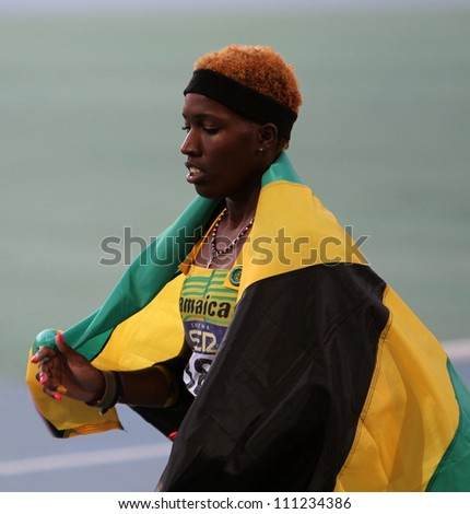 BARCELONA, SPAIN - JULY 14: Janieve Russell from Jamaica the winner of 400 meters hurdles on IAAF World Junior Athletics Championships on July 14, 2012 in Barcelona, Spain - stock photo