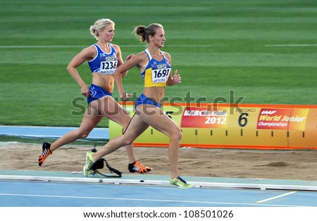 BARCELONA, SPAIN - JULY 14: (L-R) Henna Palosaari and Nataliia Bashly compete in the 800 meters Heptathlon on the 2012 IAAF World Junior Athletics Championships on July 14, 2012 in Barcelona, Spain.
