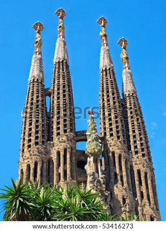 BARCELONA SPAIN - JULY 19: La Sagrada Familia - the impressive cathedral designed by Gaudi, which is being build since 19 March 1882 and is not finished yet July 19, 2009 in Barcelona, Spain. - stock photo