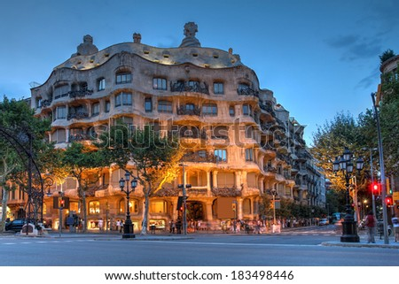 BARCELONA, SPAIN - JULY 28: Twilight scene of Casa Mila (La Pedrera) in Eixample, Barcelona on July 28, 2012. Casa Mila an apartment building, is one of Antoni Gaudi's most famous works. - stock photo