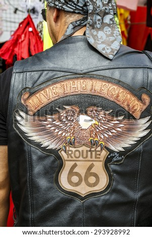 BARCELONA, SPAIN - JULY 04, 2014: typical biker jacket a Harley Davidson motorbike at an exhibition during BARCELONA HARLEY DAYS 2015. Distinctive groups and related associations. - stock photo