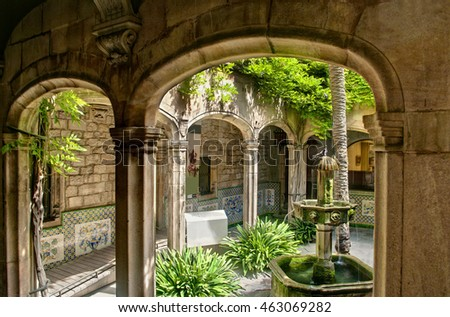 BARCELONA, SPAIN - 28 JULY, 2016: View of small yard inside Cathedral of the Holy Cross and Saint Eulalia, also known as Barcelona Cathedral, with small fountain and two pigeons sitting on it