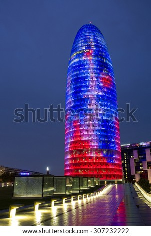 BARCELONA, SPAIN - JULY 31: View of Torre Agbar by night on July 31, 2015, in Barcelona, Spain. The 38-storey tower was designed by famous architect Jean Nouvel. - stock photo