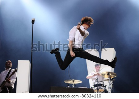 BARCELONA, SPAIN-JUN 25: Howlin' Pelle Almqvist, singer of The Hives band, performs at Universidad Complutense on June 25, 2011 in Madrid, Spain. First edition of Dcode Festival. - stock photo
