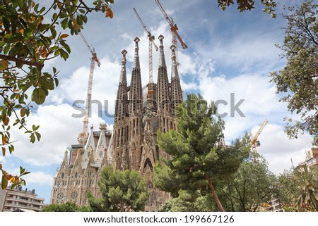 BARCELONA SPAIN - JUNE 9: La Sagrada Familia - the impressive cathedral designed by Gaudi, which is being build since 19 March 1882 and is not finished yet June 9, 2013 in Barcelona, Spain - stock photo