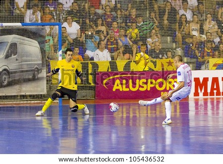 BARCELONA, SPAIN - JUNE 17: Miguelin Sayago (R) of El Pozo in action at Spanish Futsal League match between FC Barcelona and El Pozo Murcia, final score 4 - 1, on June 17, 2012, in Barcelona, Spain. - stock photo