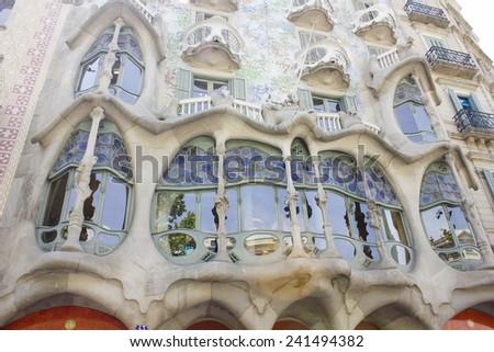 BARCELONA, SPAIN - JUNE 29, 2013: Outdoor view Gaudi's creation-house Casa Batlo. The building that is now Casa Batllo was built in 1877 by Antoni Gaudi. JUNE 29, 2013 in Barcelona, Spain. - stock photo