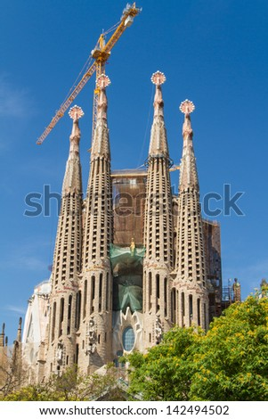BARCELONA, SPAIN -JUNE 25: Sagrada Familia on JUNE 25, 2012: La Sagrada Familia - the impressive cathedral designed by architect Gaudi, which is being build since March 19, 1882 and is not finished.