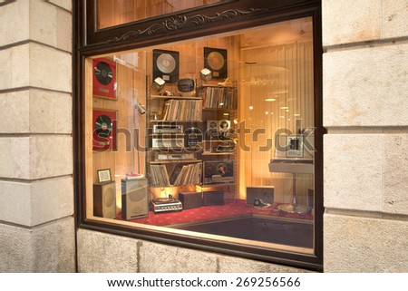 BARCELONA, SPAIN - 21 JUNE 2013: storefront of Limited Edition sneakers shop in vintage style of 70 ies.