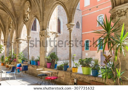 BARCELONA, SPAIN - JUNE 25. The Cafeteria Bar del Convent in the former Cloister of Saint Augustin, in the Barcelona district La Ribera on June 25, 2015. The Bar is in the backyard of an old cloister - stock photo