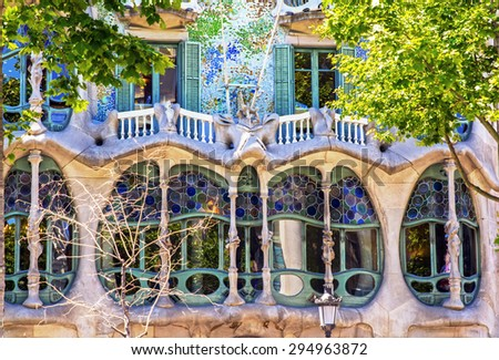 BARCELONA, SPAIN - JUNE 06, 2015: The facade of the house Casa Battlo (also could the house of bones) designed by Antoni Gaudi with his famous expressionistic style - stock photo