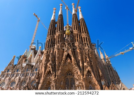 BARCELONA, SPAIN - JUNE 12, 2014: The famous Catholic basilica of the Sagrada Familia in Barcelona, Catalonia, Spain. Designed by Antoni Gaudi. Start of construction, 1882 - stock photo