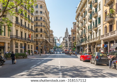 BARCELONA, SPAIN - JUNE 30. The main street Via Laietana is the name of a major thoroughfare in Barcelona on June 30, 2015. Lots of shops and main attractions are around the street - stock photo
