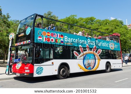 BARCELONA, SPAIN - JUNE 1, 2014: Touristic bus in front of Sagrada Familia. Barcelona City Tour is a new official touristic bus service that shows the city with an audio guide.  - stock photo