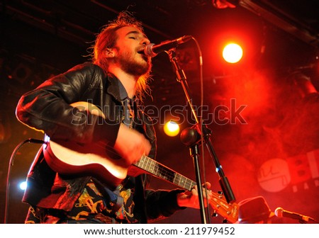 BARCELONA, SPAIN - MAR 21: Carlos Sadness, better known as Shinoflow (Spanish singer, composer and illustrator) sings at Bikini Club on March 21, 2014 in Barcelona, Spain.