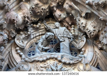 BARCELONA SPAIN - MARCH 8: La Sagrada Familia - the impressive cathedral designed by Gaudi, which is being build since 19 March 1882 and is not finished yet March 8, 2013 in Barcelona, Spain.   - stock photo