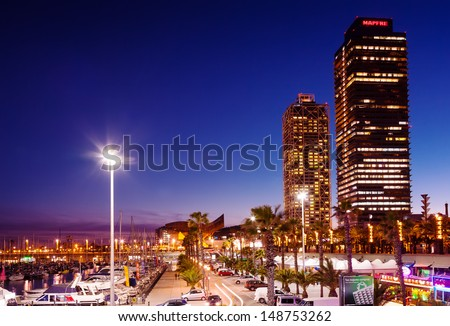 BARCELONA, SPAIN - MARCH 18: Night view of Port Olimpic in March 18, 2013 in Barcelona, Spain. It hosted the sailing events for the 1992 Summer Olympics. Now - center of nightlife