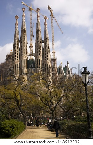 BARCELONA, SPAIN - MARCH 15, 2010: The Sagrada Fami­lia is a privately-funded Roman Catholic church that has been under construction in Barcelona since 1882 in Barcelona, Spain on March 15, 2010. - stock photo