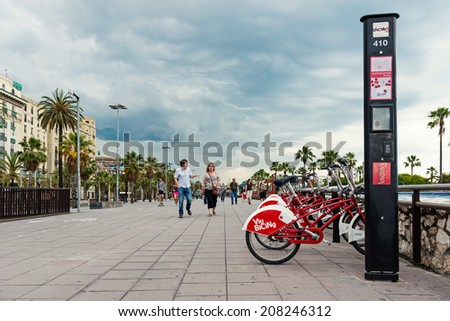 BARCELONA, SPAIN - MAY 31, 2014: Bicycle of the Cycle service in Barcelona sponsored by Vodafone. With the bicing sharing service people can rent bicycles for short trips.  - stock photo