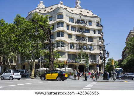Barcelona, Spain - May 19 2016: Casa Mila in Barcelona. This famous building was designed by the faboulos architect Antoni Gaudi, included in the list of UNESCO. - stock photo