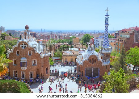 BARCELONA, SPAIN - MAY 22, 2015 Ceramic mosaic Park Guell - the famous architectural town art designed by Antoni Gaudi and built in the years 1900 to 1914