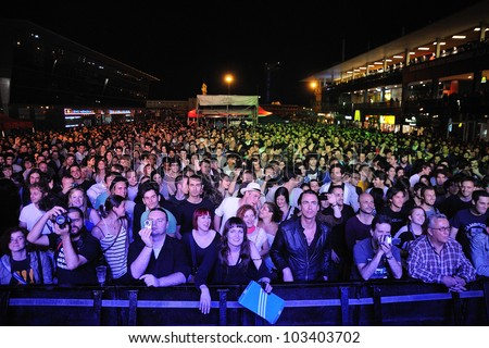 BARCELONA, SPAIN - MAY 12: Fans at Maremagnum on May 12, 2012 in Barcelona, Spain. La Pla�§a Odissea Festival. - stock photo