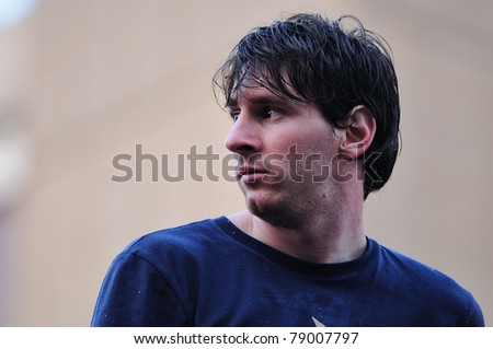 BARCELONA, SPAIN - MAY 13: Lionel Messi, F.C Barcelona player, celebrates Spanish League victory with thousand of fans in the streets on May 13, 2011 in Barcelona, Spain. - stock photo