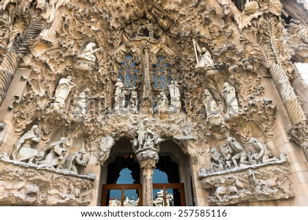BARCELONA, SPAIN - MAY 12: Nativity Facade of Sagrada Familia on May 12, 2013 in Barcelona, Spain. The impressive cathedral designed by Antoni Gaudi is being built since 1882 and is not finished yet - stock photo