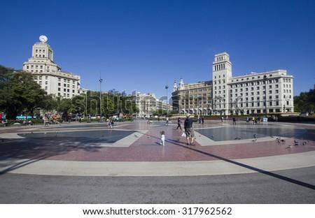 Barcelona, Spain - May 21, 2015: People walk around on Plaza Catalunya in Barcelona, Spain on May 21, 2015. - stock photo