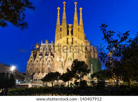 BARCELONA, SPAIN - MAY 12: Sagrada Familia at night on May 12, 2013 in Barcelona, Spain. The impressive cathedral designed by Antoni Gaudi is being built since 1882 and is not finished yet - stock photo