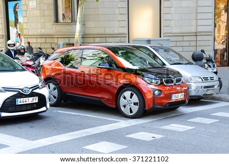 BARCELONA, SPAIN - MAY 27: The BMW i3 electric car is on street of Barcelona city on May 27, 2015 in Barcelona, Spain. Up to 60 mln tourists is expected to visit Spain in year 2015. - stock photo
