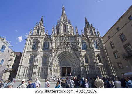 Barcelona, Spain - May 21, 2015: Tourists in front of the Cathedral of Barcelona, Spain on May 21, 2015.