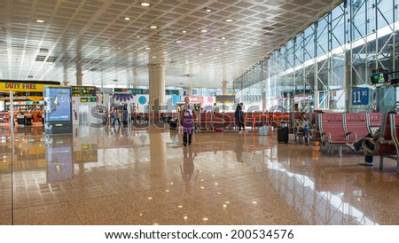 BARCELONA, SPAIN - MAY 30, 2014: Waiting room inside El Prat International Airport. The airport is the second largest in Spain and 31st busiest in the world, and is the main airport of Catalonia.