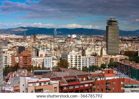 BARCELONA, SPAIN - NOVEMBER 09, 2013: Barcelona centre seen from the Montjuic mountain. Visible Archdiocese, Torre Agbar and Edificio Colon - stock photo