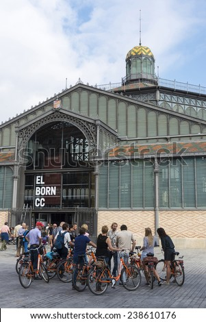 Barcelona, Spain - November 2, 2014: cycling tour group with a guide in front of the old Born market - stock photo
