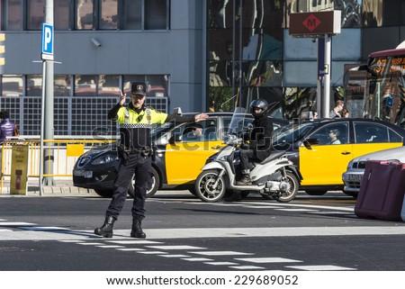 Barcelona, Spain - November 7, 2014: Police directing traffic in a square in Barcelona.  - stock photo