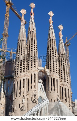 Barcelona, Spain - November 9, 2015: Sagrada Familia is a large Roman Catholic church in Barcelona, designed by Antoni Gaudi. Although incomplete, the church is a UNESCO World Heritage Site. - stock photo
