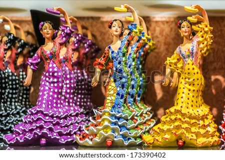 BARCELONA, SPAIN - NOVEMBER 17, 2013: Traditional souvenir from Barcelona: the figures of dancing girls in traditional Spanish national dresses.