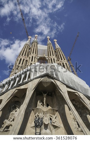 BARCELONA, SPAIN - OCTOBER 08, 2015: Back of The Sagrada Familia Cathedral designed by Gaudi, which is being build since 1882 and is not finished yet. - stock photo