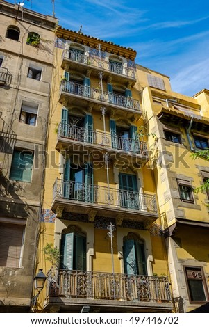 BARCELONA,SPAIN-OCTOBER 5,2016: Detail old facade houses in Ciutat Vella district, historic center of Barcelona.